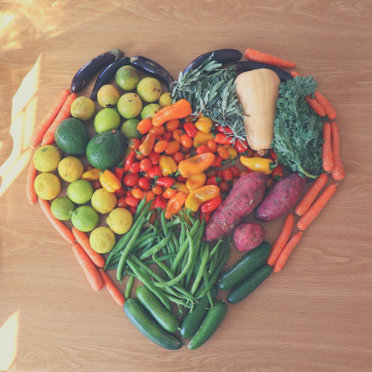 Fresh harvest laid out to form the shape of a heart.